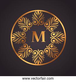 gold luxury letter M in frame circular