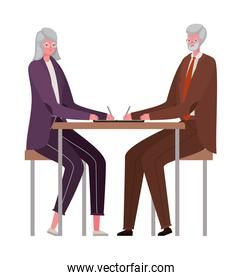 Senior woman and man cartoons at desk vector design