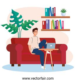 home working, freelancer young man with laptop on sofa, working from home in relaxed pace, convenient workplace
