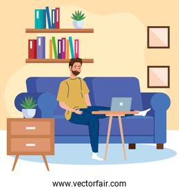 home working, freelancer man with laptop on sofa, working from home in relaxed pace, convenient workplace