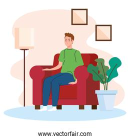 young man sitting in sofa, living room home place