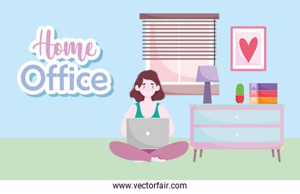home office workspace, woman using laptop sitting floor in room with table lamp plant and books