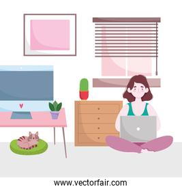 home office workspace, woman works at home with laptop and cat on cushion