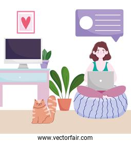 home office workspace, woman on cushion using laptop in the room with cat computer and plants