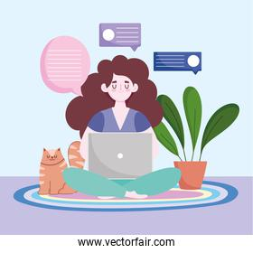 home office workspace, freelancer using laptop with cat and plant on floor