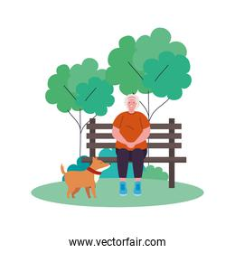 cute old woman with dog in the park