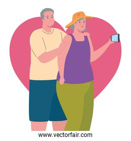 cute old couple taking a selfie with smartphone in heart background