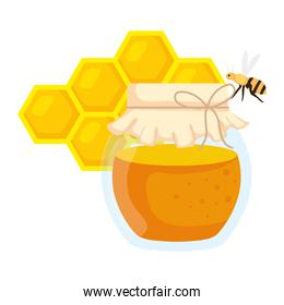 honeycomb with bee flying and honey jar on white background