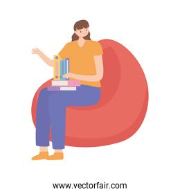 young woman with book sitting on bean chair isolated design white background