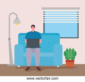 telework, man with laptop in the living room, working from home