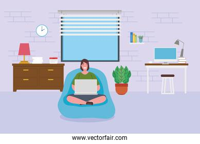 telework, woman sitting in pouf with laptop, working from home