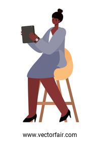 seated black woman with tablet on chair working vector design