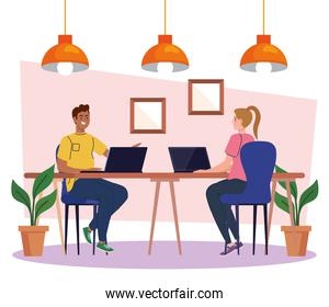 coworking space, couple in desk with laptops, team working concept