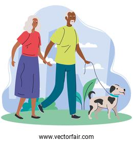 old couple afro walking with dog pet in the park