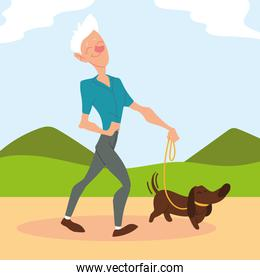 old man walks a dog in park, active senior