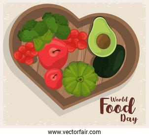 world food day poster with vegetables in wooden heart board