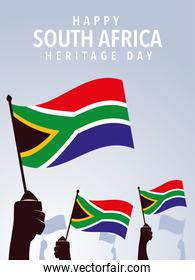 happy South African heritage day, hands holding flags of South Africa