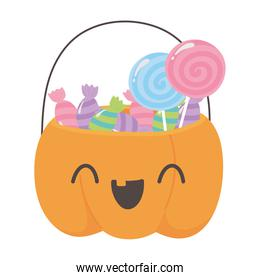 happy halloween pumpkin shaped bucket with many candies