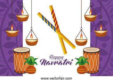 happy navratri celebration with drums and candles hanging