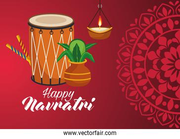 happy navratri celebration with drum and candle hanging