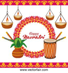 happy navratri celebration with drum and candles hanging