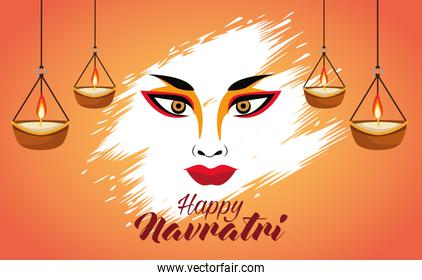 happy navratri celebration with goddess amba face and candles hanging