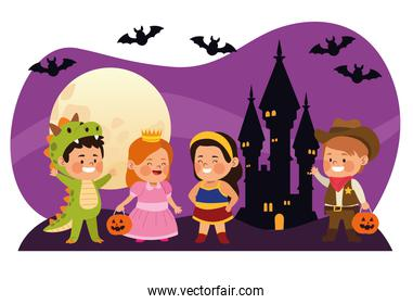 cute little kids dressed as a differents characters with bats in castle night scene