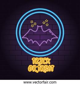 trick or treat neon light of bat flying with stars