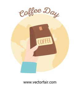 international day of coffee, hand holding package