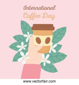 international day of coffee, hand with takeaway cup leaves and flowers card