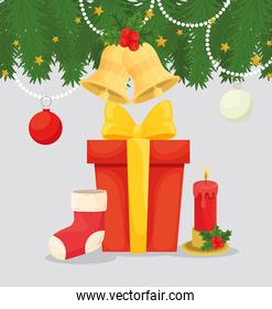 merry christmas gift with boot and candle vector design