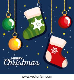 christmas socks with balls hanging, banner of new year and merry christmas celebration