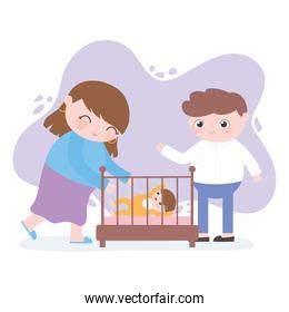pregnancy and maternity, mom and dad with baby in crib