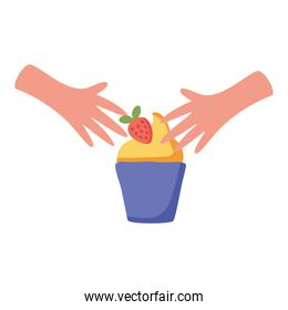 hands with sweet cupcake and strawberry isolated icon