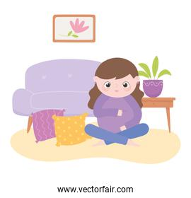 pregnancy and maternity, cute pregnant woman sitting in the living room
