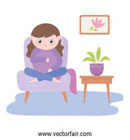 pregnancy and maternity, cute pregnant woman sitting on chair