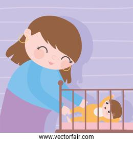 pregnancy and maternity, cute mother with her baby in crib