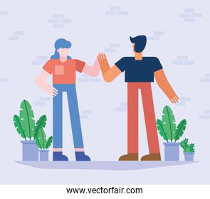 Coworking of woman and man with plants vector design