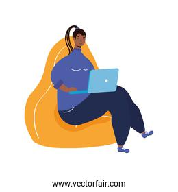 afro ethnic woman with rasta hairstyle working in laptop seated in sofa character