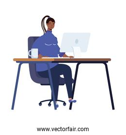 afro ethnic woman with rasta hairstyle working in desktop workplace scene
