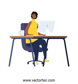 afro ethnic woman working in desktop workplace scene