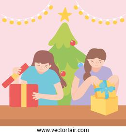 happy girls opening gift boxes in the christmas party