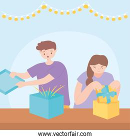 surprised boy and girl opening gift boxes in the party celebration
