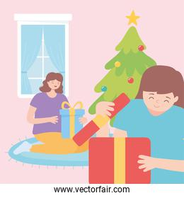 young women opening gift boxes merry christmas clelebration