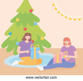 girls in christmas party sitting opening gift boxes