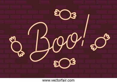 boo word halloween lettering in neon light with candies