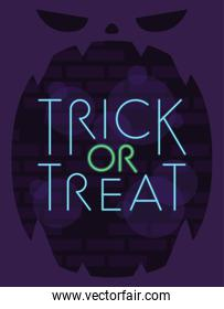 trick or treat halloween lettering in neon light with pumpkin face