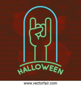 halloween lettering in neon light with hadn rock and roll symbol