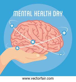 Mental Health Day lettering with hand lifting brain