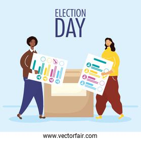 election day lettering with interracial couple lifting voting cards in box